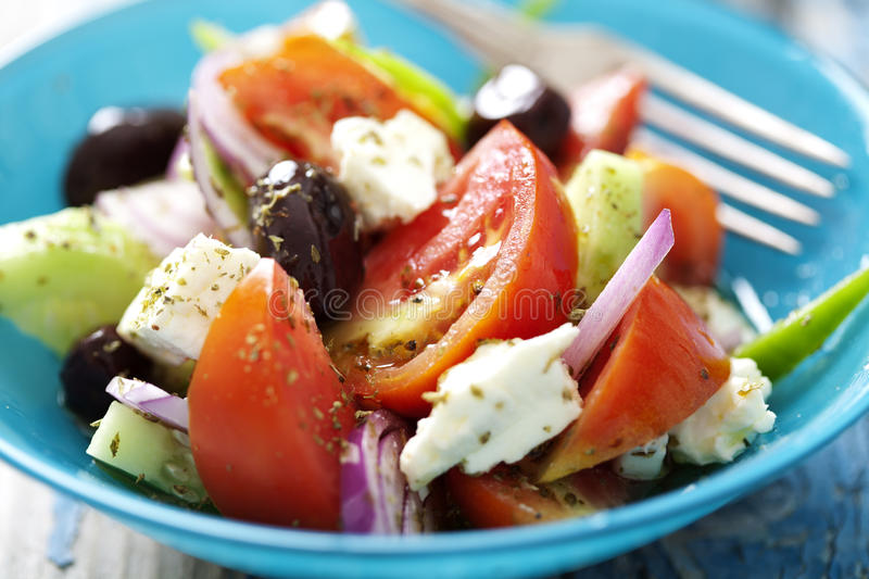 Rustic greek salad. Authentic greek salad with olive oil and oregano stock photo