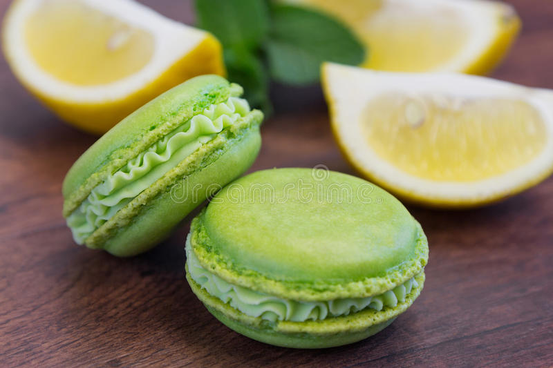 Rustic green macarons with lemon and mint. Green macaroons with lemon and mint stock photography