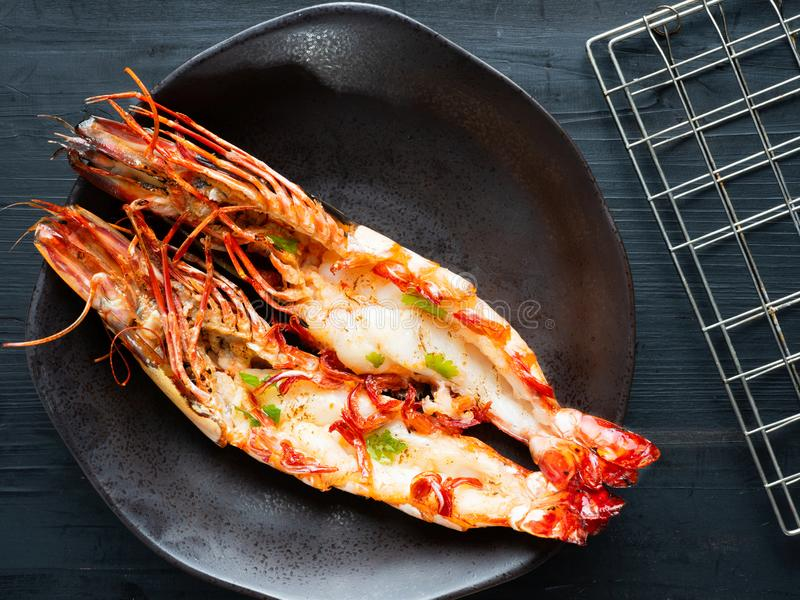 Rustic grilled jumbo prawn royalty free stock images