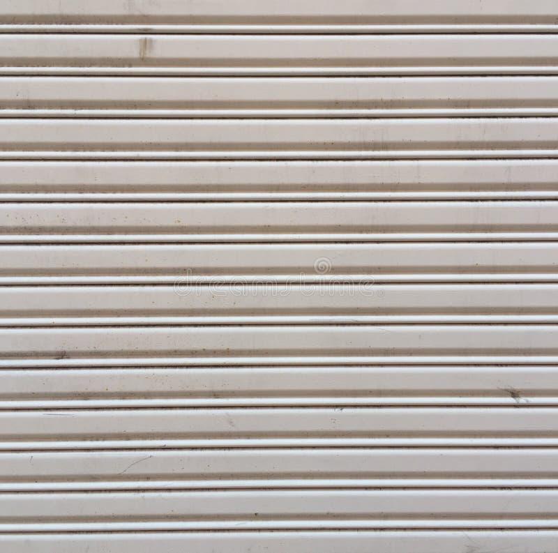 Rustic grungy urban metal door texture in white. Rustic grungy urban city metal door texture in white stock images