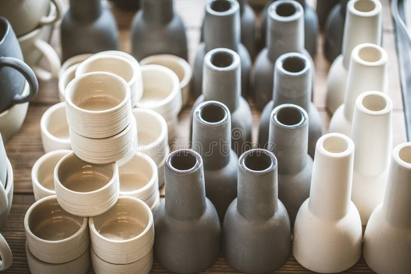 Rustic handmade ceramic clay white cups souvenirs on the Street handicraft market. Rustic handmade ceramic clay white cups souvenirs. Street handicraft market royalty free stock photos