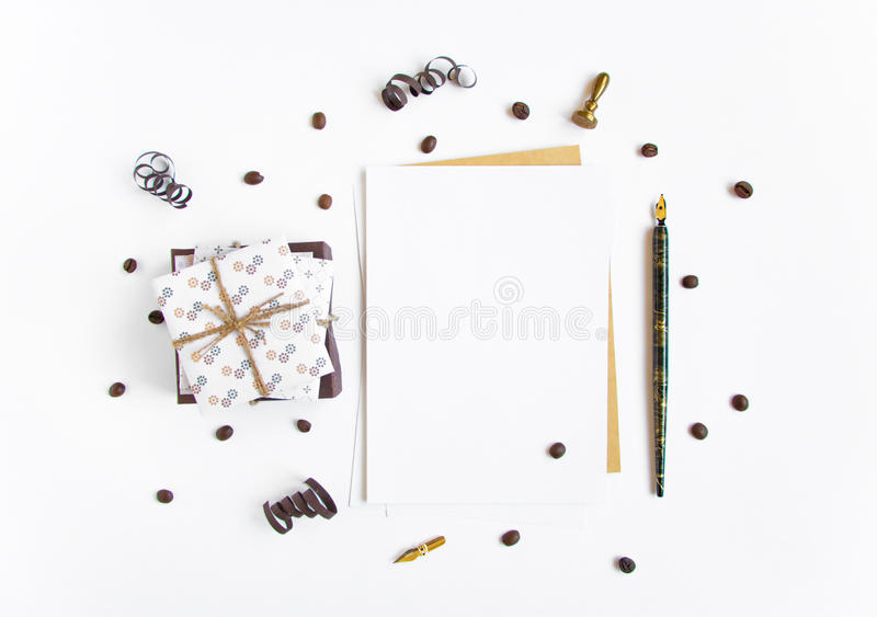 Rustic handmade gifts and a letter on white background decorated with serpentine and coffee beans. Top view, flat lay royalty free stock photography