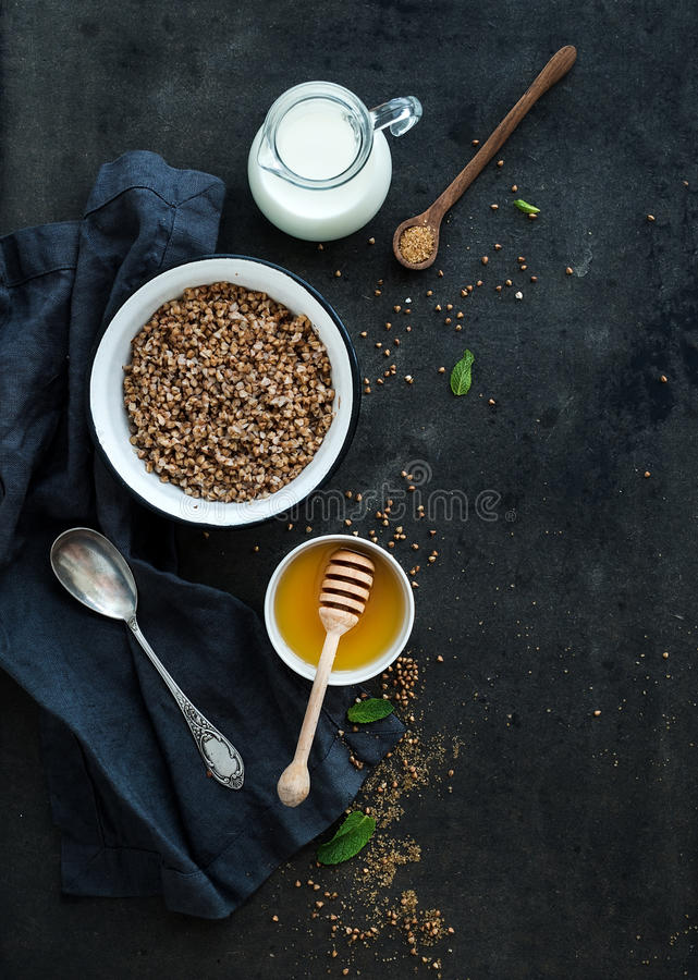 Rustic healthy breakfast set. Cooked buckwheat royalty free stock photo