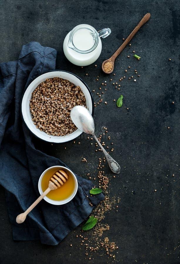Rustic healthy breakfast set. Cooked buckwheat royalty free stock photos