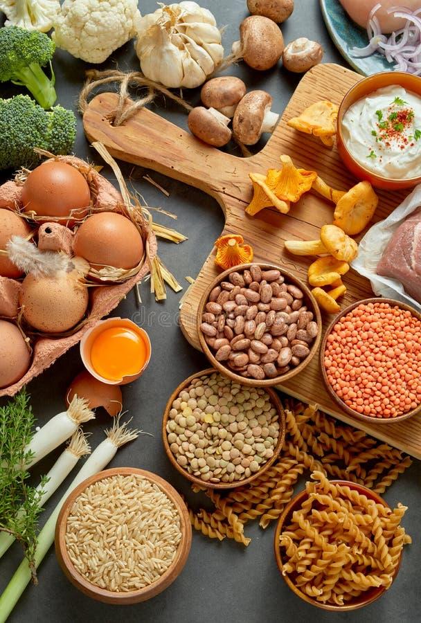 Rustic, healthy, organic paleo food assortment stock photo