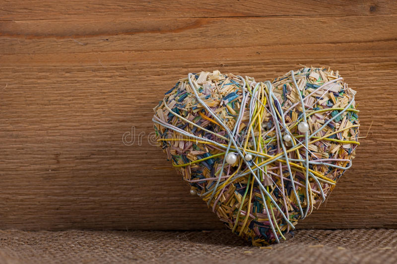 Rustic heart-shaped potpourri on wood stock images