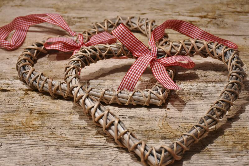 Rustic hearts with bows stock photography