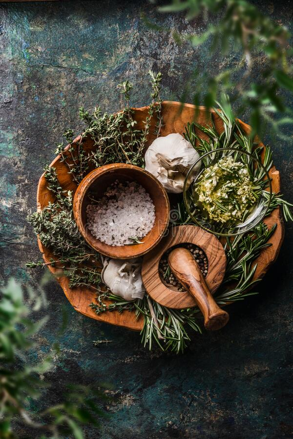 Free Rustic Herbs And Spices In Wooden Bowls On Dark Background. Top View. Rural Cooking Utensils Royalty Free Stock Photography - 180704537