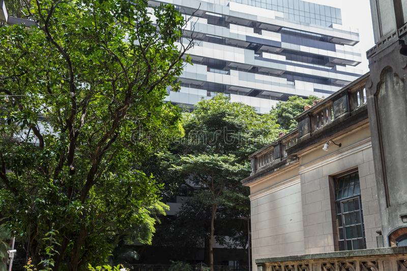 Rustic Historical Building in Contrast with Modern Building in Sao Paulo, Brazil stock images