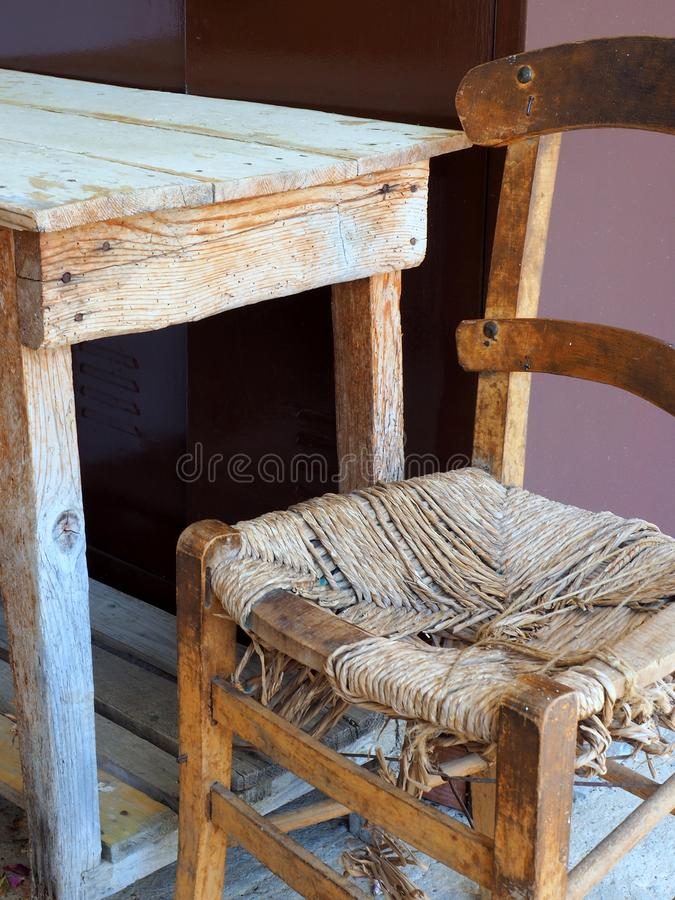 Rustic Furniture, Table and Cane Chair royalty free stock photography