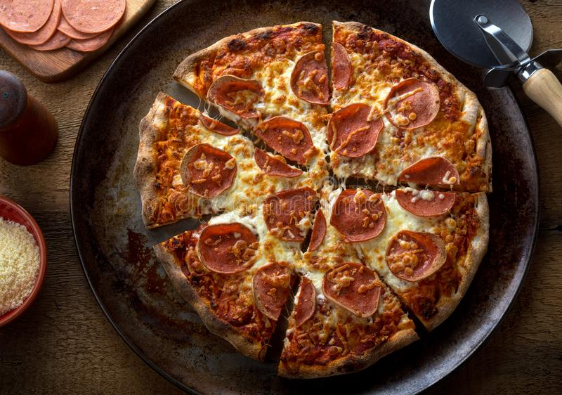 Rustic Homemade Pepperoni Pizza royalty free stock photo
