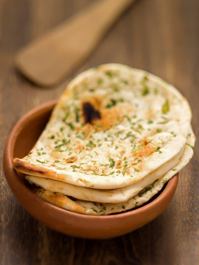 Rustic indian naan bread. Close up of rustic indian garlic and cilantro naan bread royalty free stock photos