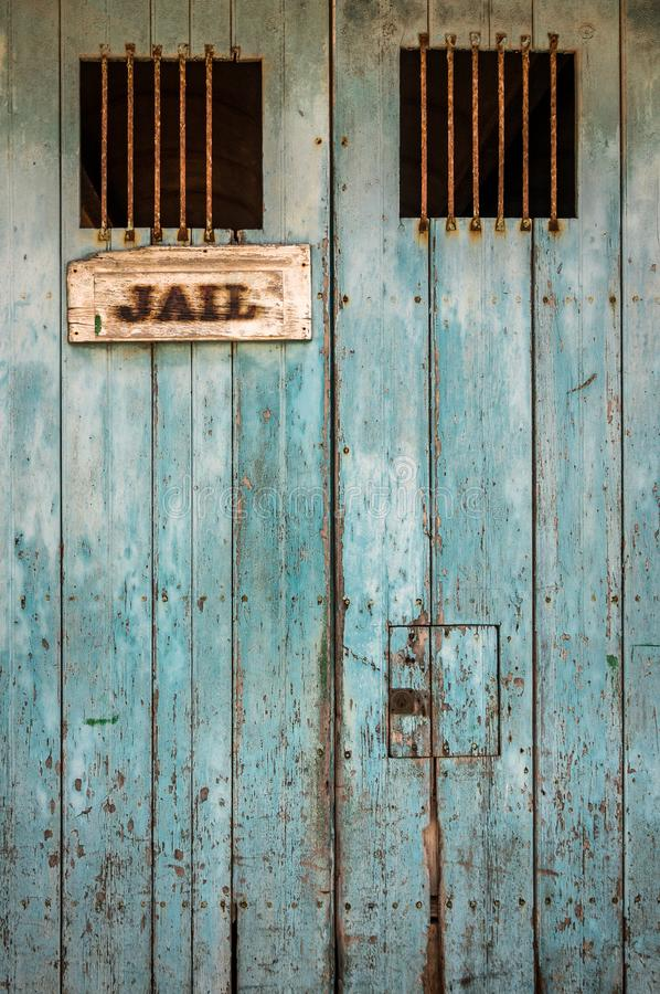 Rustic Jail Door With Bars. Detail Of A Rustic Jail Door With Bars On The Windows royalty free stock image