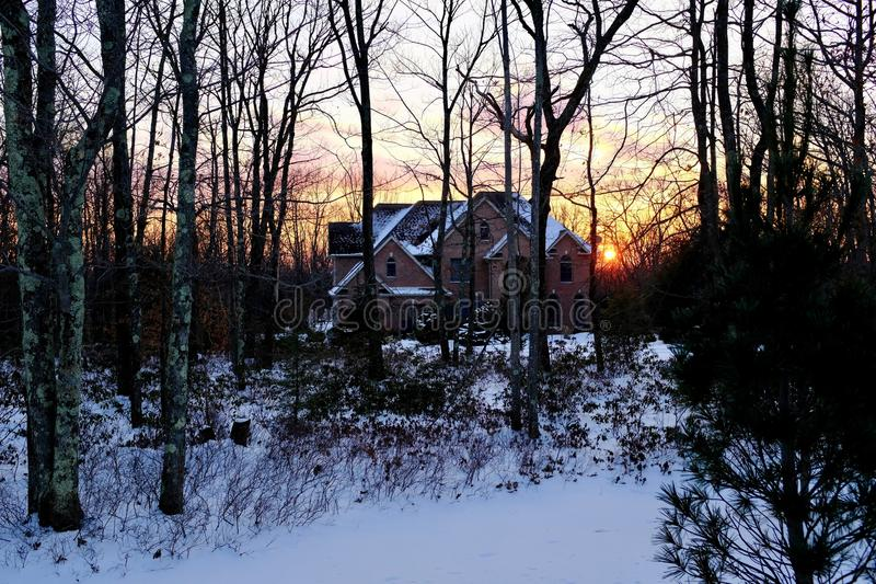 Rustic Brick Home in Country Setting at Sunset royalty free stock image