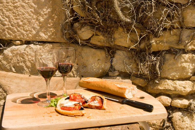 Rustic lunch in France. Rustic lunch in sunny France with bread and wine royalty free stock photo