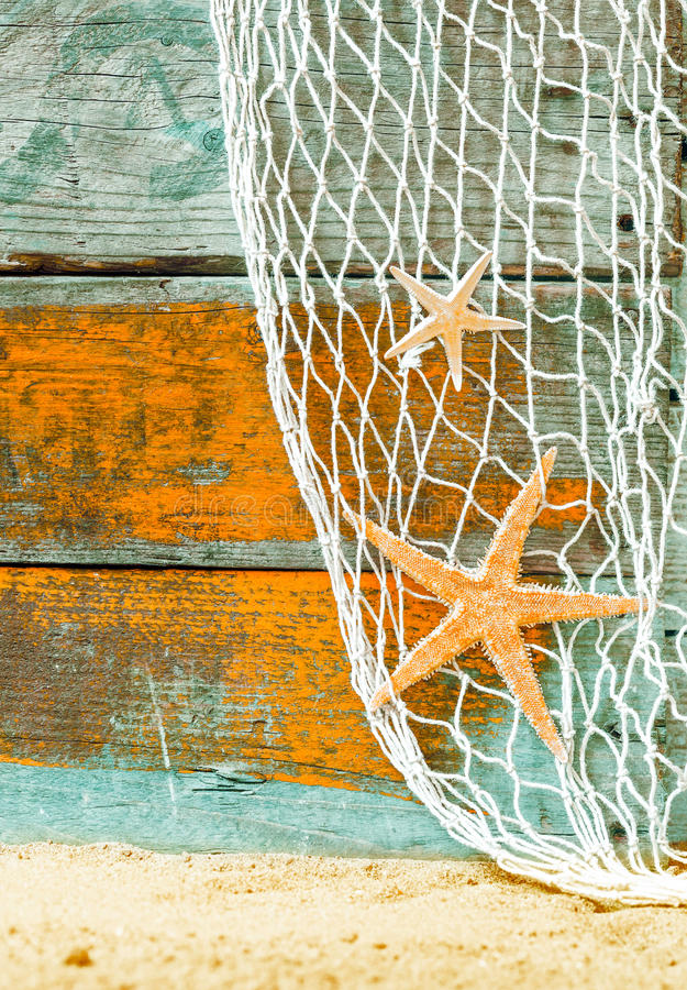Rustic marine background with starfish stock images