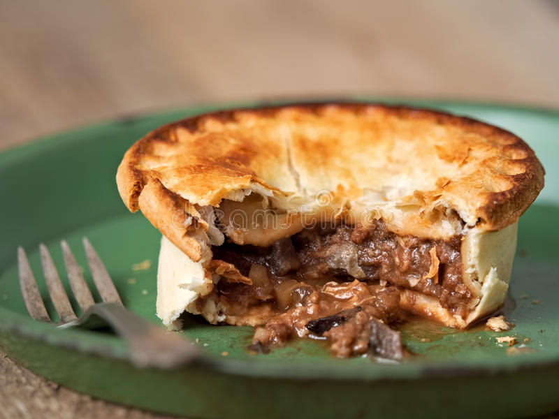 Rustic meat and mushroom pie. Close up of rustic meat and mushroom pie stock photos