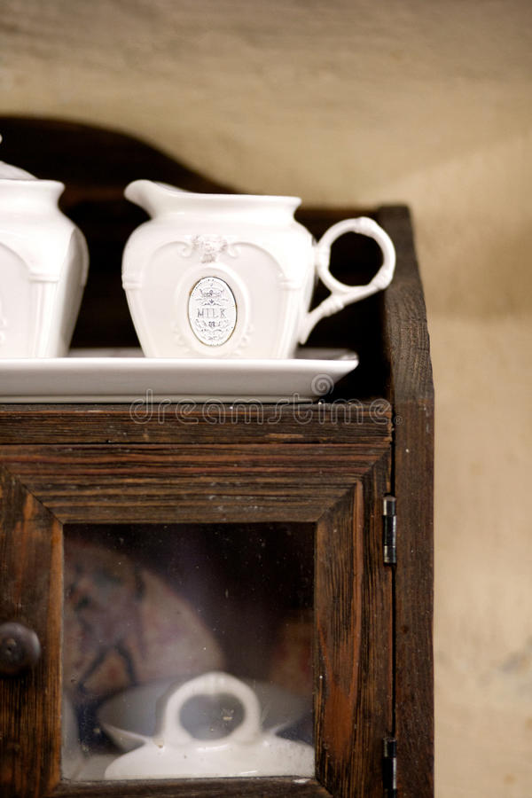 Rustic milk pot. In a cottage stock photos