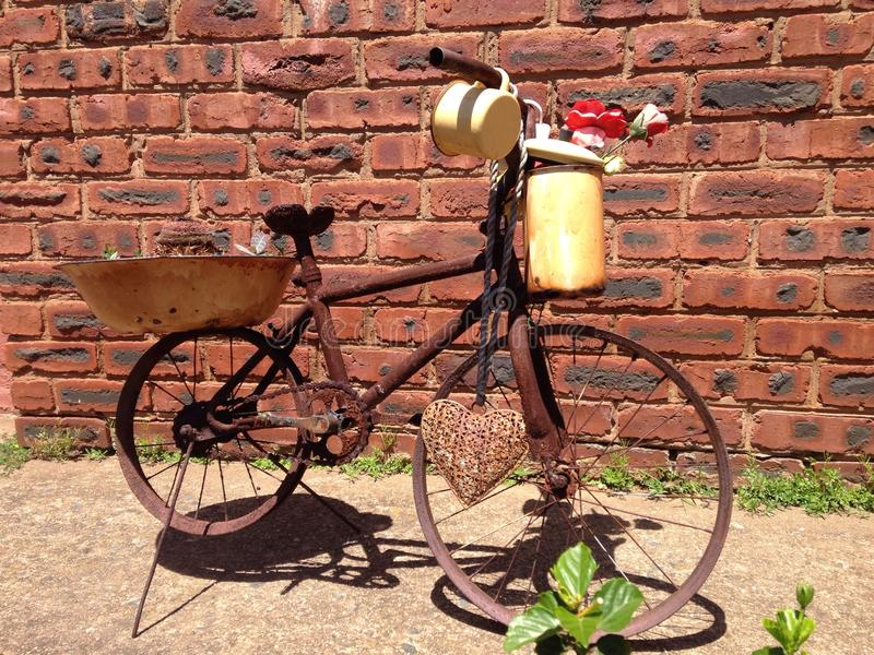 Rustic old bicycle patina covered with odds and ends royalty free stock photography
