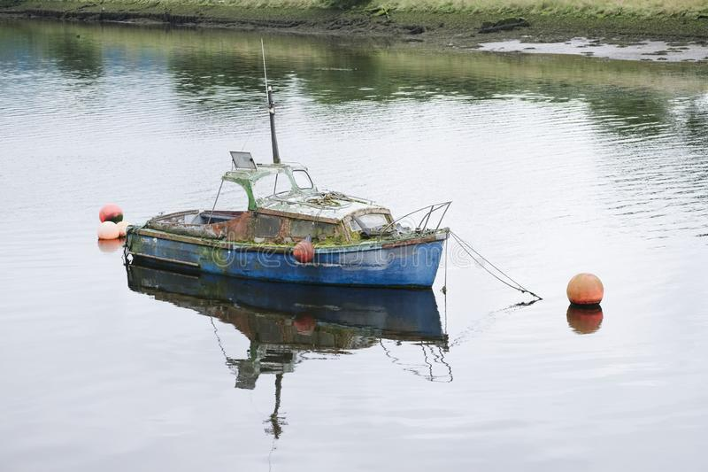 Rustic old boat red wooden moored at harbour royalty free stock photo