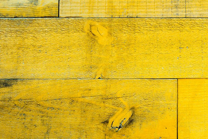 Rustic old grungy and weathered yellow wall wooden planks as wood texture stock photo