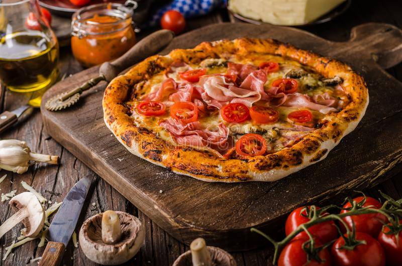 Rustic old style vintage pizza stock image