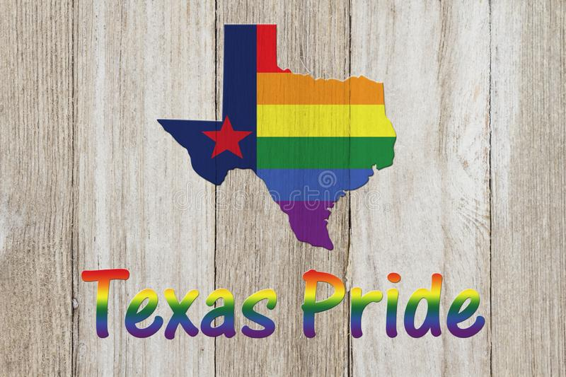 A rustic old Texas pride flag with state map on weathered wood royalty free illustration