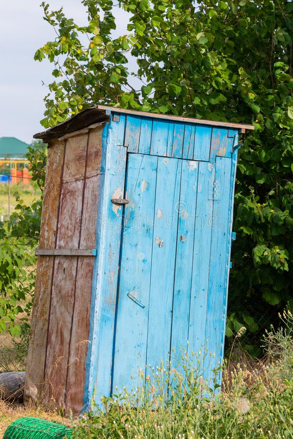 Rustic old times outdoor dry toilet in countryside.  stock photos