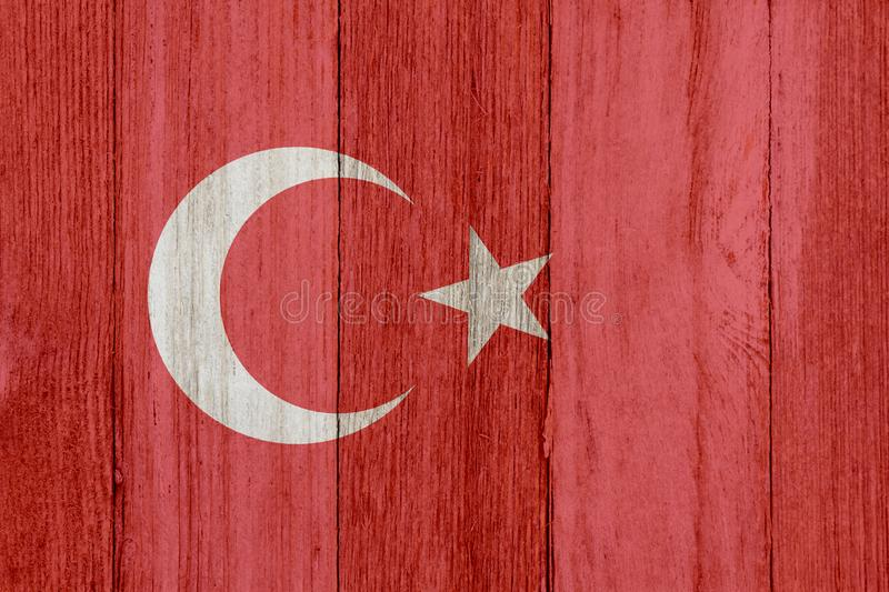 A rustic old Turkish flag on weathered wood royalty free stock photography