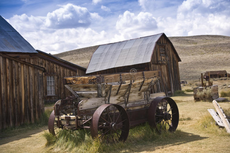 Rustic Old West Barn and Wagon stock image