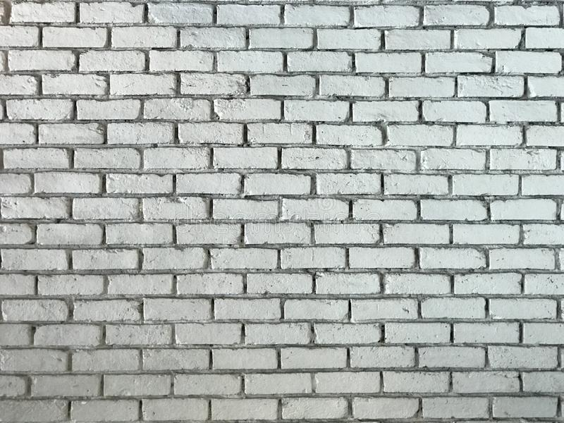 Rustic old white Brick Wall Background Image. Old White washed grunge finish weathered brick wall for use as as seamless pattern texture background royalty free stock images