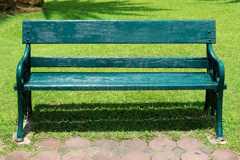 Rustic Outdoor Wooden Bench in the Park royalty free stock images
