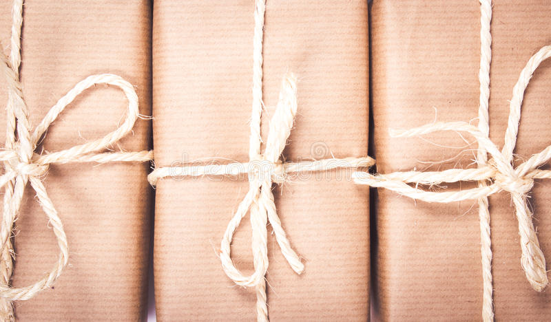 Rustic parcels gift box with kraft paper. Close up of the rustic parcels gift box with kraft paper stock image