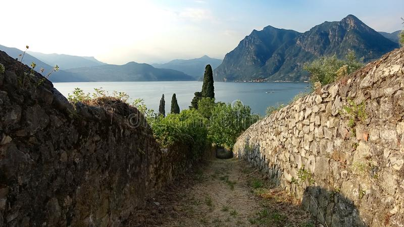 Rustic  path to felicity winding down the hills of Monte Isola royalty free stock image