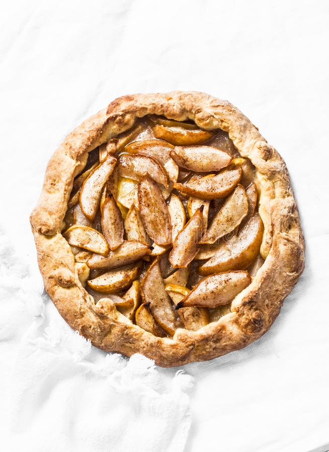 Rustic pear pie on a light background, top view. Delicious autumn dessert. stock photo