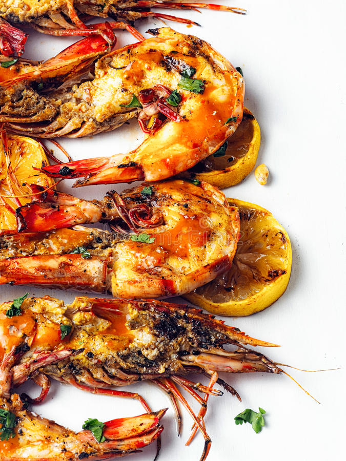 Rustic piri-piri grilled prawn stock photo