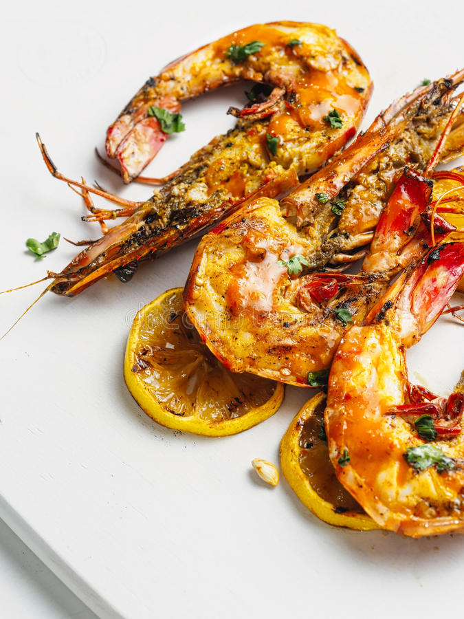 Rustic piri-piri grilled prawn stock photos