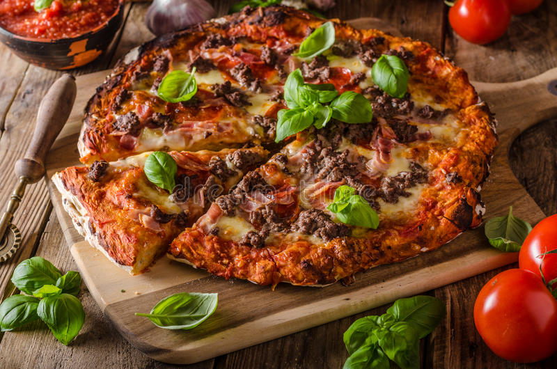 Rustic pizza with minced meat royalty free stock photos