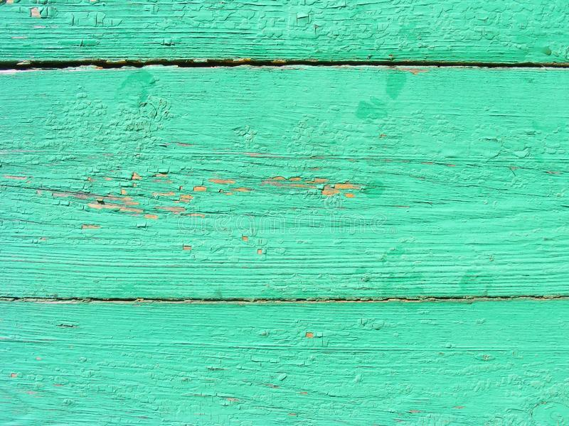 Rustic plank background of green and turquoise, weathered texture with copy space. Green empty wooden background.  Old dirty wall stock photography
