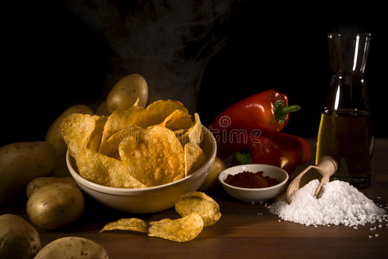 Rustic potato chips stock photos