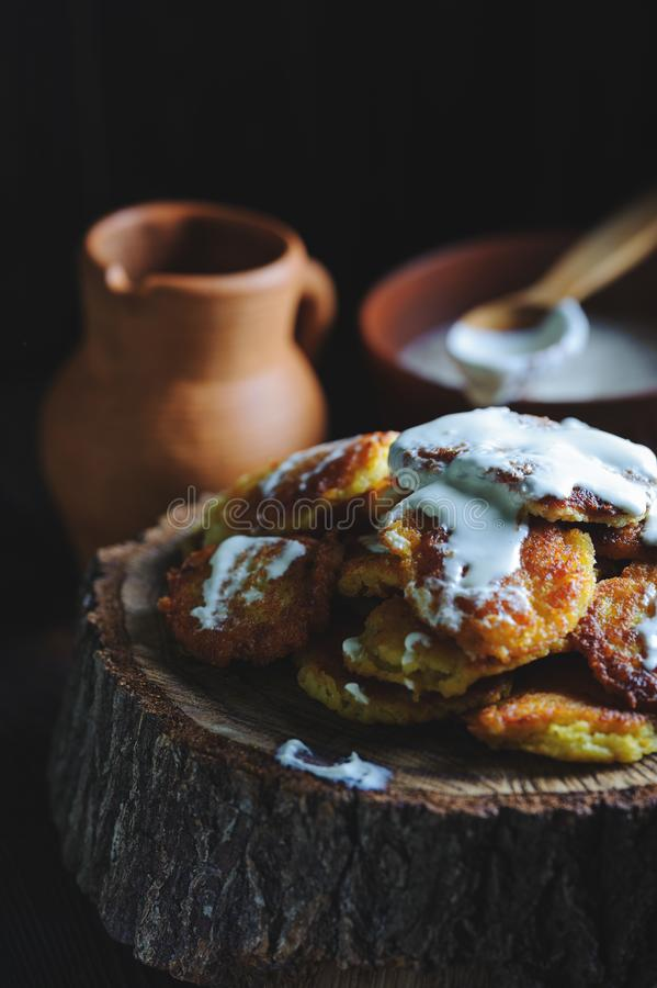 Rustic potato pancakes with sour cream stock images