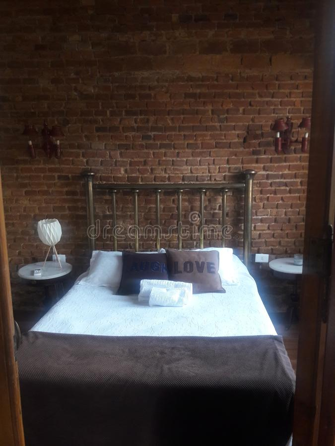 Rustic quaint bedroom with brick wall Montevideo Uruguay royalty free stock photography