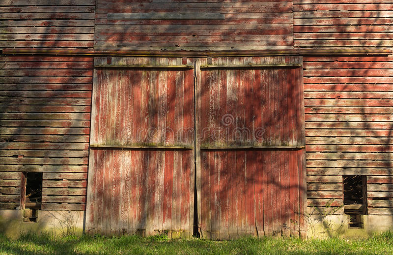 Rustic red barn doors. royalty free stock image