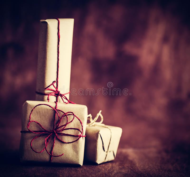 Rustic retro gifts, present boxes on wooden background. Christmas time stock photography