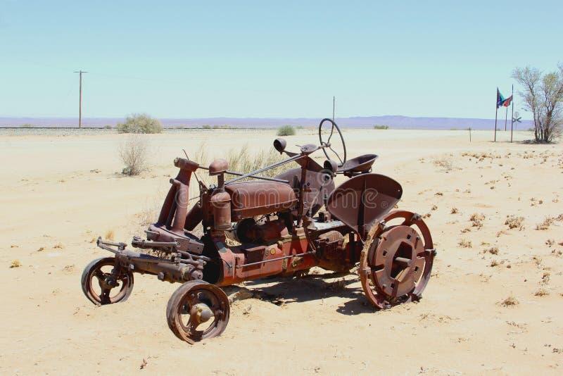 Rustic retro vintage tractor desert, Namibia, Africa. Retro vintage and rusty tractor in the middle of nowhere, the desert in Namibia, Africa stock image