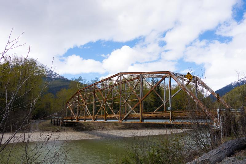 An old iron bridge in alaska royalty free stock photos