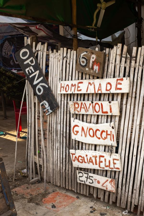 A rustic rundown sign showing a list of Italian food at a street stall in Kampot, Cambodia. Nobody in the image royalty free stock photos
