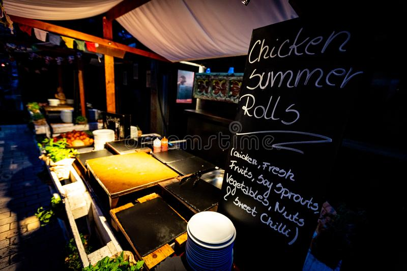 Rustic South East Asian style Street Food Stand. An exotic south East Asian pop up street food stand in restaurant with ambient lighting stock photography