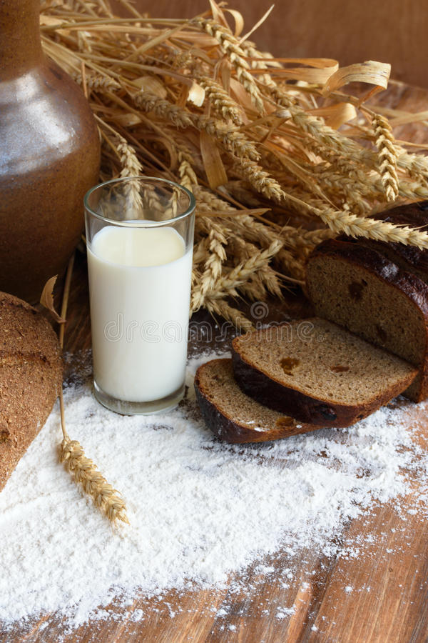 Rustic still life with a glass of milk and bread stock images