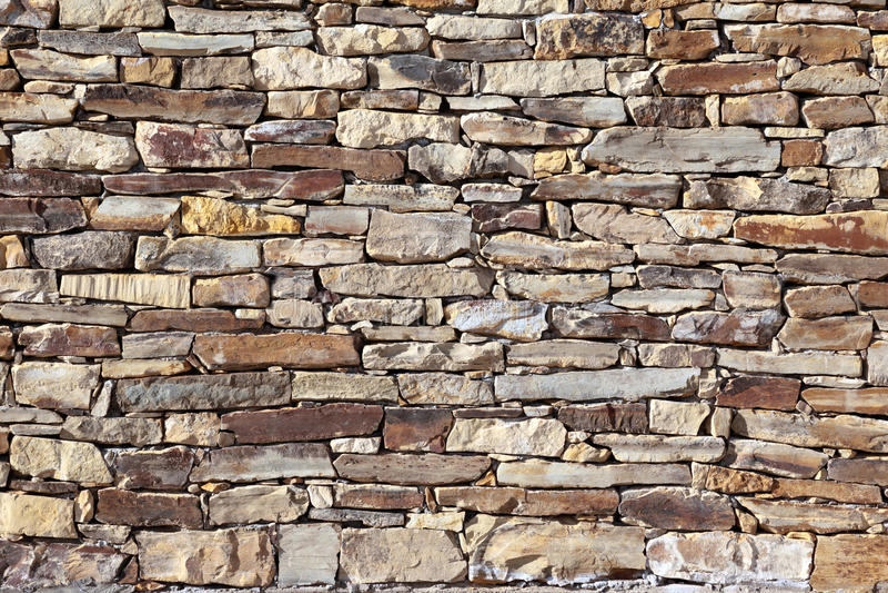 Stone brick wall. Rustic stone brick wall (texture royalty free stock photos